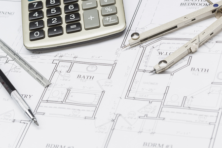 ruler: Pencil, Ruler, Compass and Calculator Resting on Custom House Plans. Stock Photo