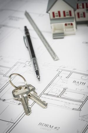 model home: Model Home, Pencil, Ruler and Keys Resting On Custom House Plans.