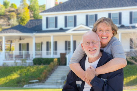 front yard: Attractive Happy Senior Couple in Front Yard of House.