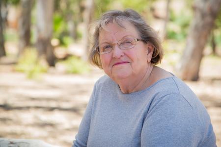 senior woman: Happy Content Senior Woman Portrait Outdoors At Park.