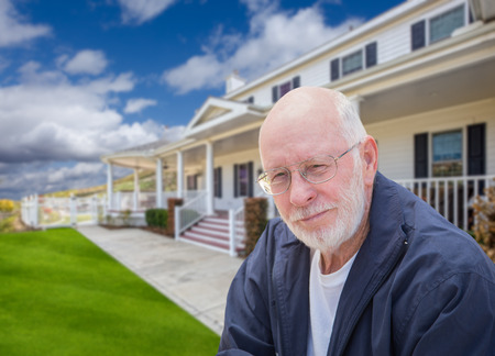 80s adult: Senior Adult Man in Front of Beautiful House. Stock Photo