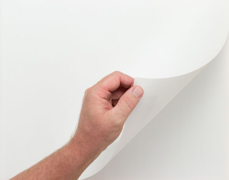Male Hand Turning Blank Page  - Contains Clipping Paths To Add Your Own Images or Text. 스톡 콘텐츠