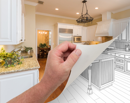 Male Hand Turning Page of Custom Kitchen Photograph to Drawing Undreneath. Banco de Imagens
