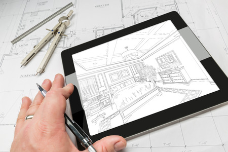 architect tools: Hand of Architect on Computer Tablet Showing Bedroom Illustration Over House Plans, Compass and Ruler.