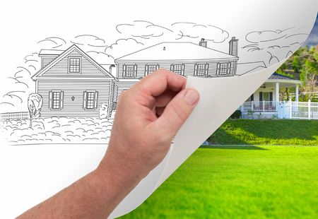 housing project: Male Hand Turning Page of Custom Home Photograph to Drawing Underneath. Stock Photo