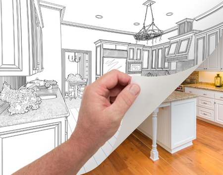 architect drawing: Male Hand Turning Page of Custom Kitchen Drawing to Finished Photograph Undreneath.