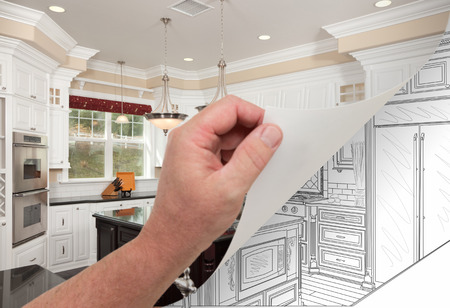 turning page: Male Hand Turning Page of Custom Kitchen Photograph to Drawing Underneath.