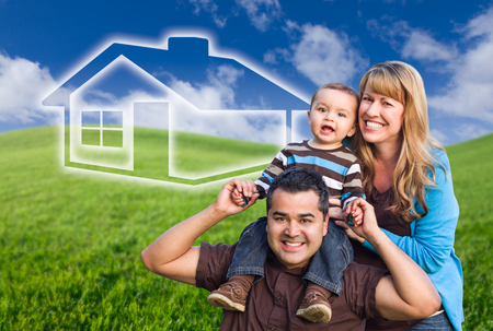 Mixed Race Family with Ghosted House Drawing and Rolling Green Hills Behind.