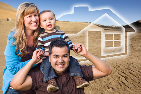 dream land: Happy Hopeful Mixed Race Family at Construction Site with Ghoosted House Behind. Stock Photo