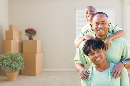 family  room: Happy African American Family In Room with Packed Moving Boxes.
