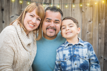mixed race: Happy Young Mixed Race Family Portrait Outside.