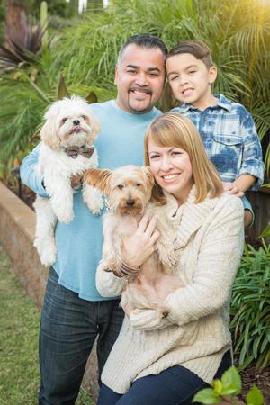 mixed race: Happy Mixed Race Family Portrait Outdoors.