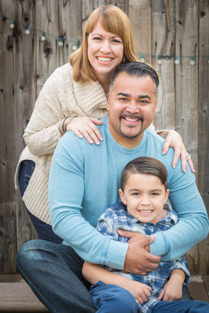 mixed race: Happy Young Mixed Race Family Portrait Ourside.
