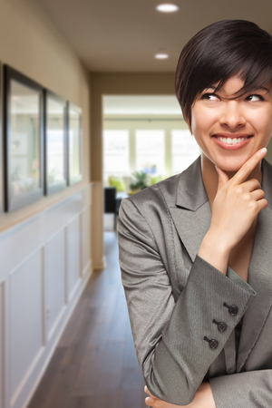 home business: Attractive Curious Mixed Race Woman Inside Hallway of New House. Stock Photo