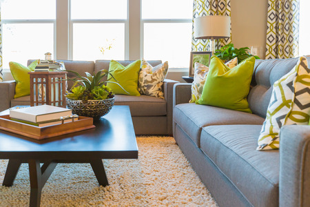 Beautiful Living Area with Coffee Table and Couch of New Home. Stock Photo