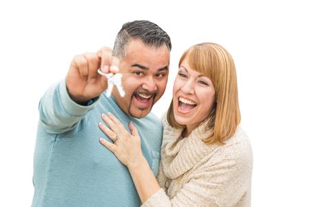 Happy Mixed Race Couple Isolated on White Holding New House Keys.