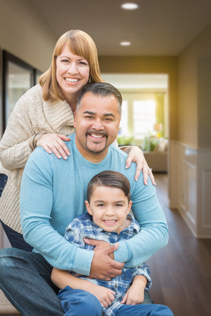 mixed race: Happy Mixed Race Family Portrait Inside Their New House.
