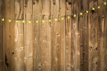 Lustrous Wooden Background with Bright String of Lights.