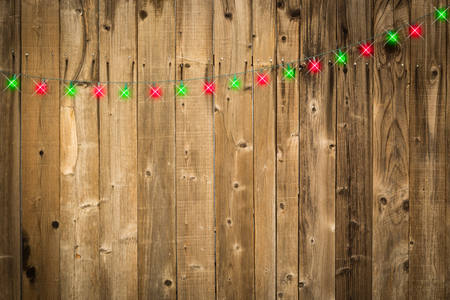 lustrous: Lustrous Wooden Background with Bright Green and Red Christmas Lights.
