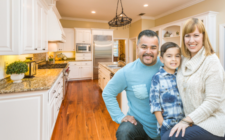 family kitchen: Happy Young Mixed Race Family Having Fun in Custom Kitchen. Stock Photo