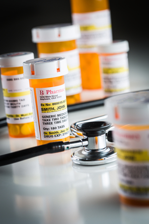 proprietary: Several Non-Proprietary Medicine Prescription Bottles Abstract with Stethoscope.