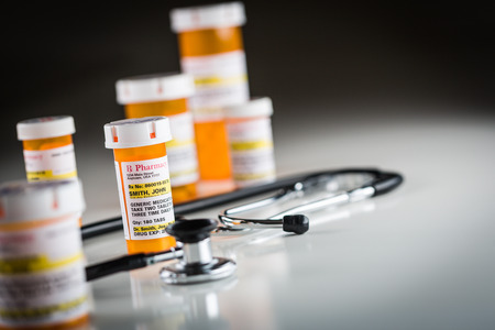 proprietary: Several Non-Proprietary Medicine Prescription Bottles Abstract with Stethiscope.