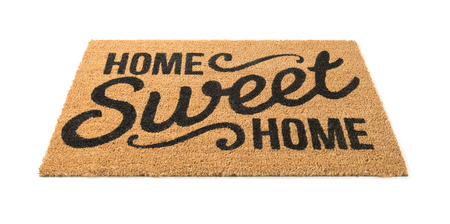 Home Sweet Home Welcome Mat Isolated on a White Background. Stock Photo