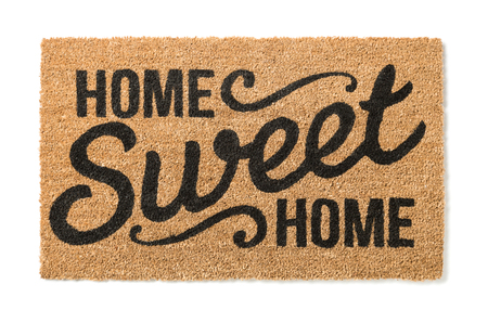 Home Sweet Home Welcome Mat Isolated on a White Background. Foto de archivo