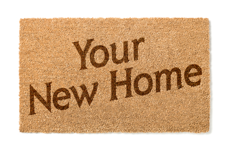 Your New Home Welcome Mat Isolated On A White Background. Stock Photo