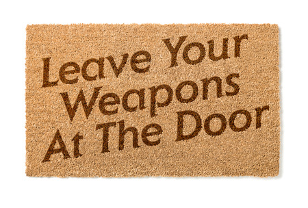 welcome mat: Leave Your Weapons At The Door Welcome Mat Isolated On A White Background. Stock Photo