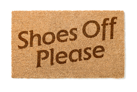 welcome mat: Shoes Off Welcome Mat Isolated On A White Background. Stock Photo