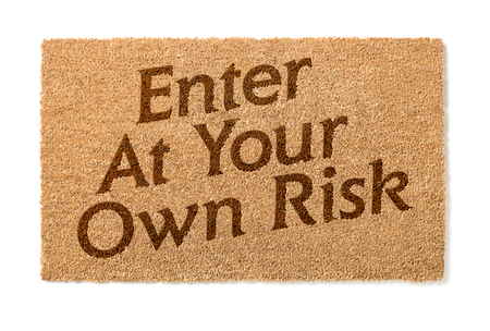 welcome mat: Enter At Your Own Risk Welcome Mat Isolated On A White Background.