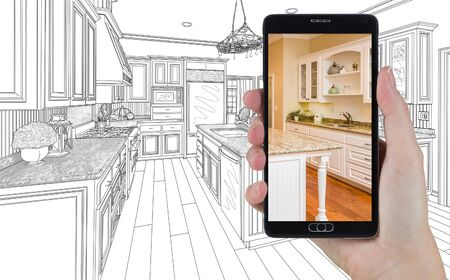 Hand Holding Smart Phone Displaying Photo of Custom Kitchen Drawing Behind.