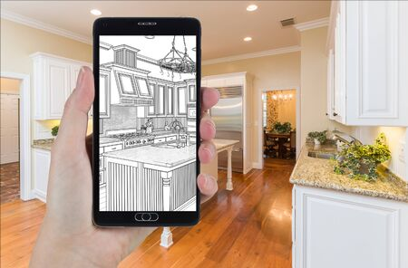 Hand Holding Smart Phone Displaying Drawing of Custom Kitchen Photo Behind.
