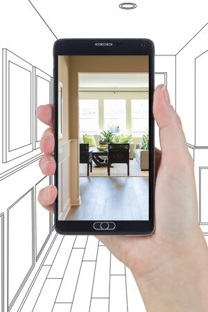 holding smart phone: Hand Holding Smart Phone Displaying Photo of the House Hallway Drawing Behind. Stock Photo