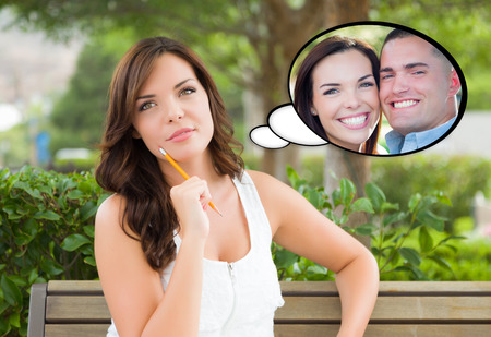 Thoughtful Young Woman with Herself and Handsome Young Man Inside Thought Bubble. Stock Photo