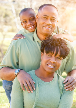 Beautiful Happy African American Family Portrait Outdoors At The Park. photo