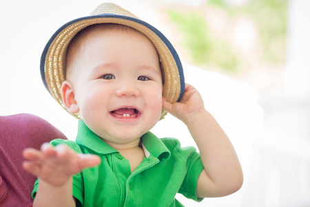 Portrait of A Happy Mixed Race Chinese and Caucasian Baby Boy Wearing His Hat Stock fotó