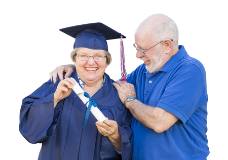 Senior Adult Woman Graduate in Cap and Gown Being Congratulated By Husband Isolated on White.