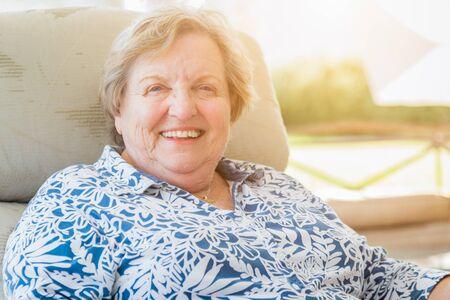 Pretty Senior Woman Portrait on Patio. photo