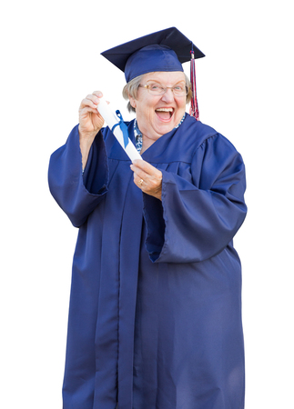 Happy Senior Adult Woman Graduate In Cap and Gown Holding Diploma Isolated on a White Background. photo