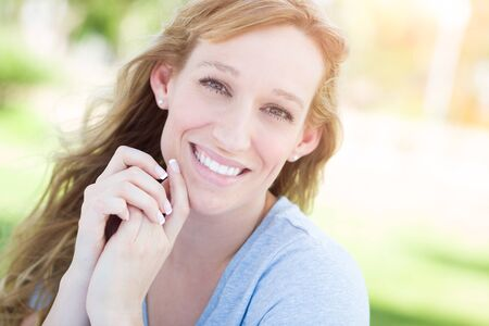 young adult woman: Outdoor Portrait of Young Adult Brown Eyed Woman. Stock Photo