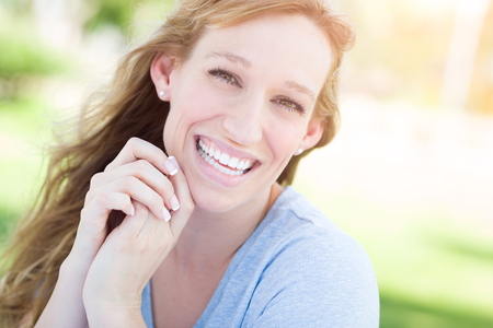 Outdoor Portrait of Young Adult Brown Eyed Woman. Stock Photo