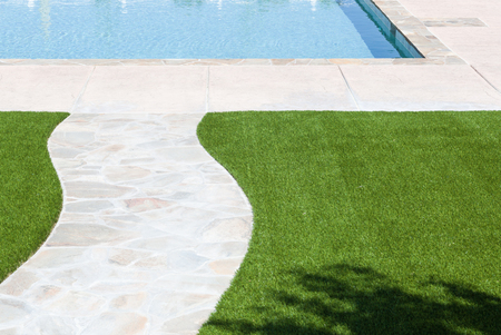 New Artificial Grass Installed Near Walkway and Pool.