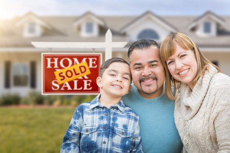 front house: Mixed Race Family In Front of House and Sold For Sale Real Estate Sign Stock Photo