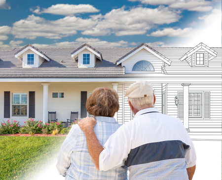 Senior Couple Looking At New House Drawing Gradating Into Photograph. photo
