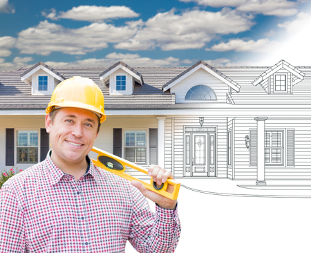 front or back yard: Male Contractor Wearing Hard Hat In Front of House Drawing Gradation Into Photograph.
