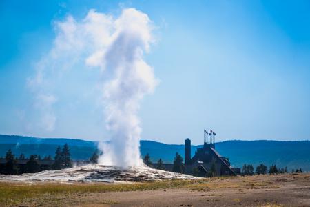 Old Faithful Geyser Erupting at Yellowstone National Park.