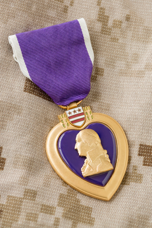 Purple Heart Medal Laying on Military Fatigues