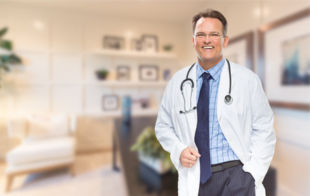 Handsome Doctor or Nurse Standing In His Office. photo